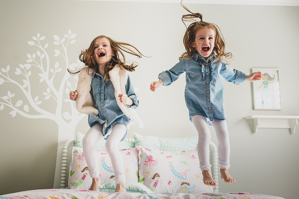 kids jumping on the bed in Geneva IL